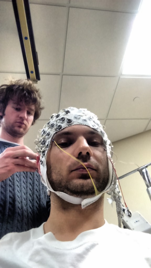 Ben attaches electrodes to me before bed in the University of Wisconsin sleep lab.